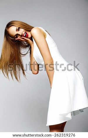 High fashion look.glamor sexy stylish blond surprised young woman model with bright makeup with perfect sunbathed clean skin in white summer dress with red lips - stock photo