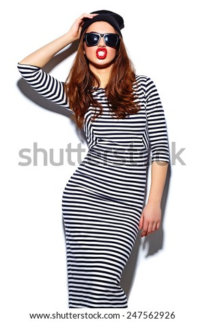 High fashion look.glamor stylish beautiful  young happy smiling woman model with red lips  in zebra dress in black beanie - stock photo