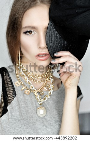 High fashion look.glamor stylish beautiful  young woman model with pale lips  in hipster gray cloth in  cap Girl having fun - stock photo