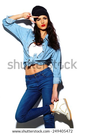 High fashion look.glamor stylish beautiful  young woman model with red lips  in summer bright colorful jeans  hipster cloth in black beanie - stock photo