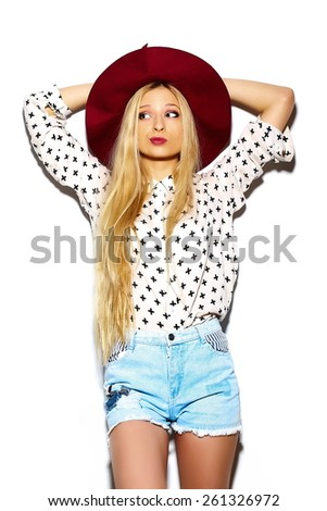 High fashion look.glamor stylish sexy smiling beautiful young blond woman model in summer bright jeans hipster cloth  in red hat
