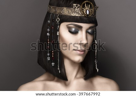 High fashion look. Glamorous closeup portrait of beautiful sexy stylish brunette young woman model with bright  makeup with perfect clean skin with gold jewelery. Cleopatra - stock photo