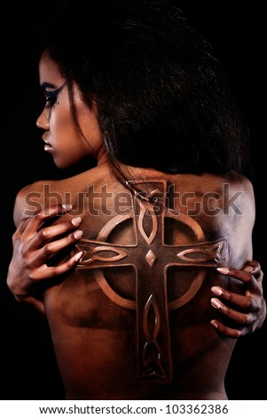 High fashion look.glamour closeup portrait of beautiful black American woman  with tattoo on back and bright makeup - stock photo