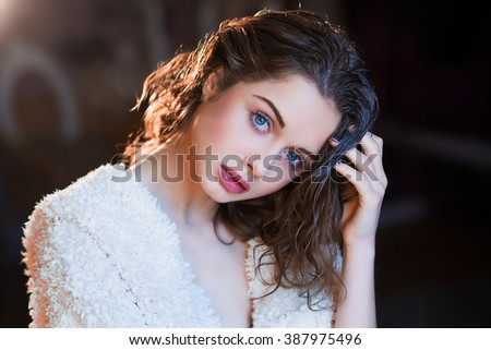 High fashion look. Portrait of a fashionable model.Close up. Studio shot. Portrait of a blond model with wet hair and clean skin after shower - stock photo