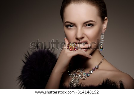 High-fashion Model Girl Beauty Woman high fashion Vogue Style Portrait beautiful fashionable Luxury lady precious jewelry diamond ring necklace earrings Stylish Perfect skin  lips passion aggression - stock photo