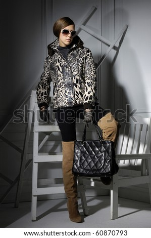 High fashion model with posing in the studio - stock photo