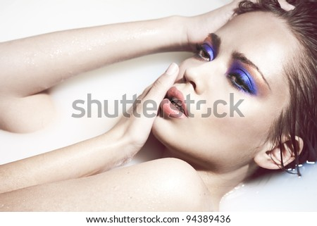 High fashion portrait of a sexy woman with creative makeup - stock photo