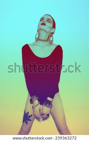 high fashion portrait of beautiful girl with tattoo. jewelry. bright background. - stock photo
