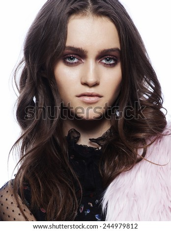 high fashion portrait of beautiful young brunette girl with smoky make up  isolated on white background - stock photo