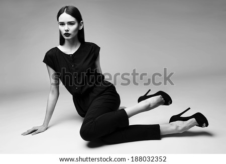 high fashion portrait of young elegant woman.Black and white studio shot  - stock photo