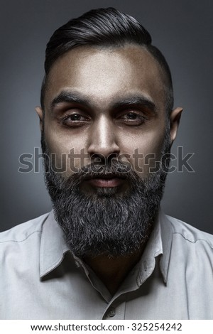 High fashion style portrait of bearded man with awesome haircut, esquire style - stock photo