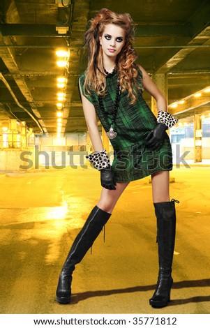 High fashion urban portrait of young, slim, beautiful model. - stock photo