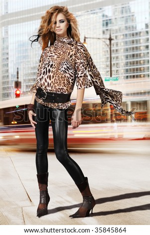 High fashion urban portrait of young, slim, beautiful model. - stock photo