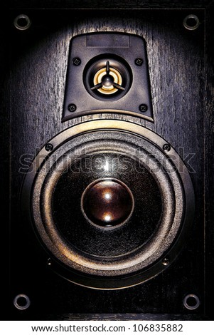 High fidelity audio stereo system sound speaker enclosure with low bass and treble tweeter loudspeaker cone drivers - stock photo
