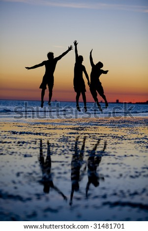 High Five at Sunset - stock photo