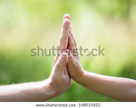 High five gesture of father and child - stock photo