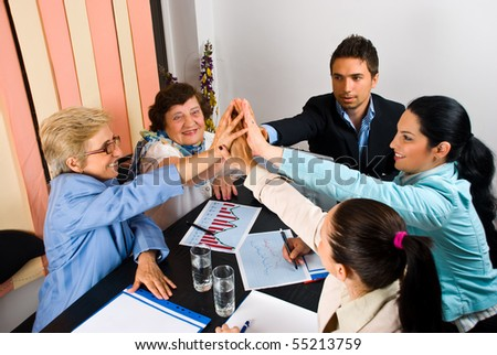 High five of businesspeople with success in business or team spirit - stock photo