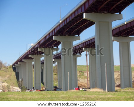 High freeway bridge over an industrial valley - stock photo