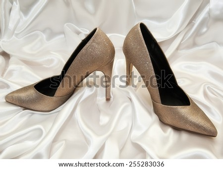 high heel women shoes on white silk background - stock photo