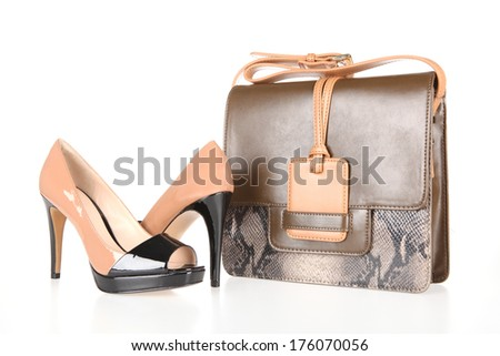 high-heeled boots and leather bag - stock photo