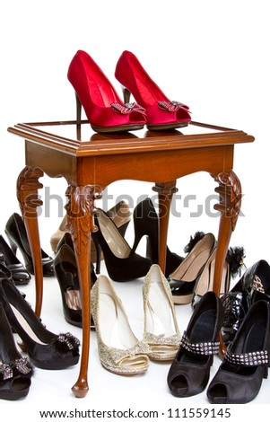 High heels in different colors on table