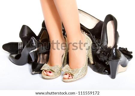 High heels in different colors, womens leg, girls leg, female foot - stock photo