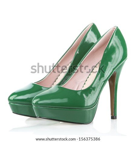 High Heels shoes with platform sole, green patent leather  - stock photo