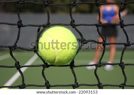 high impacting tennis ball in net on powerful ace serve