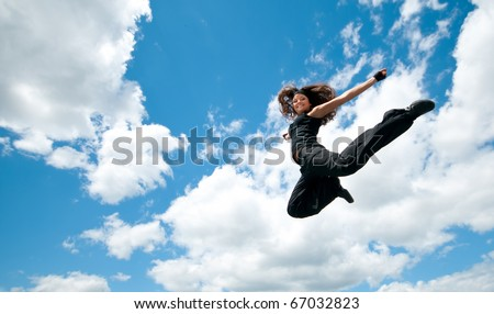 High jum. Flying woman over sky