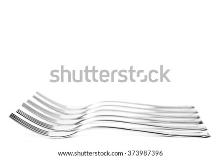 High-key composition with forks