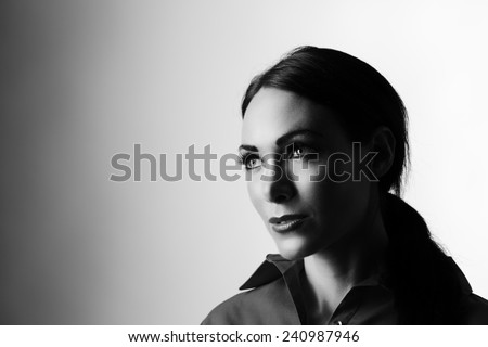 high key portrait of a beautiful women thinking