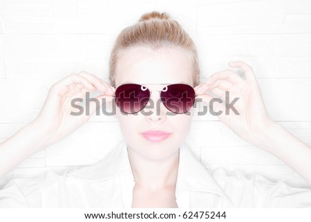High Key Portrait of a stylish girl with sunglasses - stock photo