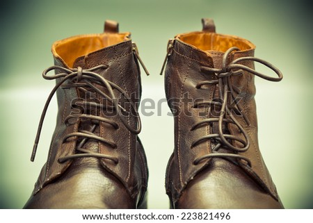 High leather shoes with laces close up, photo tinted in green