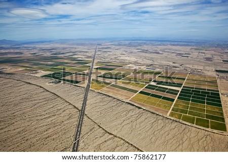 High level aerial view of farmland in the desert between Phoenix and Casa Grande, Arizona - stock photo