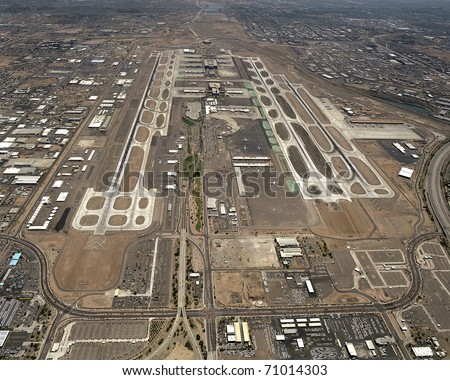 High level view of all runways and operations at major airport, west to east - stock photo
