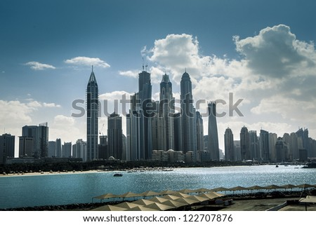 high luxury blue building skyscraper, bay ocean - stock photo