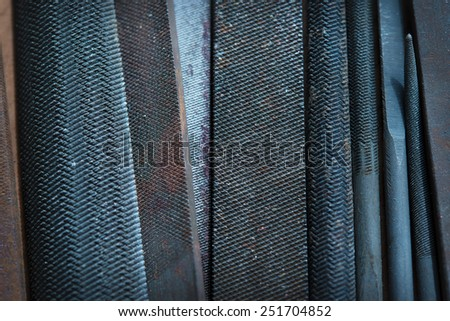 High magnification macro of metal file teeth, Shallow depth of field due to subject size. - stock photo