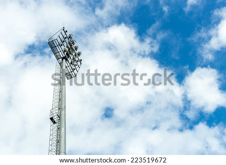 High mast of spot light with cloud on blue sky background.