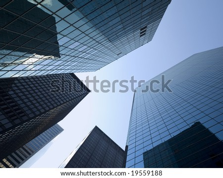 High modern skyscraper on a background of a bright sky. - stock photo