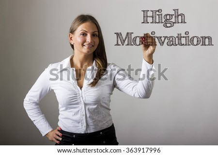 High Motivation - Beautiful girl writing on transparent surface - horizontal image