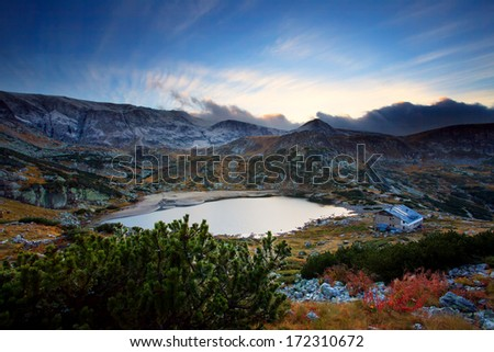 high mountain circus lake in bulgarian Rila mountain, stunning sunset over the winter peak