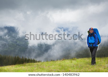 High mountain climber tourist traveling bad weather