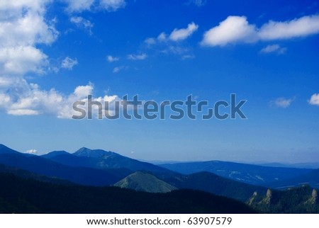High mountain scenery in summer with blue sky and white clouds, Poland, Tatra Mountain - stock photo