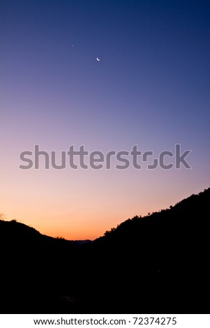 high mountain silhouette with beautiful colorful sky. - stock photo
