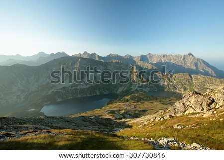High mountains around the valley in the Polish Tatras, Carpathians. - stock photo
