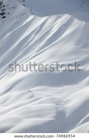 High mountains covered with snow - stock photo