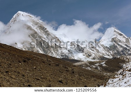 High mountains in cloud. Nepal. Near Everest