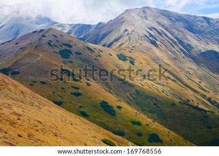 High mountains in Europe. Tatras, Poland. Nature reserve. Czubik (1846 m) and Konczysty Wierch (2002 m) view from Trzydniowianski Wierch (1758 m)  - stock photo