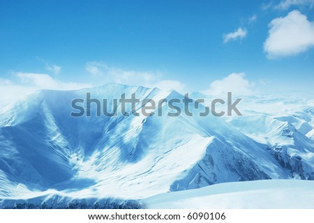 High mountains under snow in the winter - more similar photos in my portfolio - stock photo