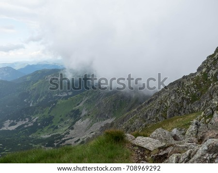 High mountains, white clouds and blue sky. Panorama of Low Tatras.